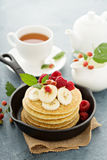 Fluffy buttermilk pancakes with bananas Royalty Free Stock Photo