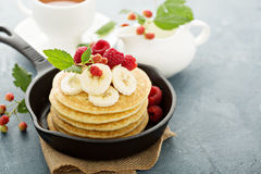 Fluffy buttermilk pancakes with bananas Royalty Free Stock Photography
