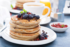 Fluffy chocolate chip pancakes for breakfast. With fresh berries and syrup Stock Image