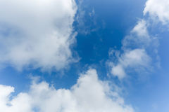Fluffy cloud above blue sky background Stock Image