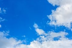 Fluffy cloud against blue sky background Royalty Free Stock Photo
