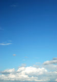 Fluffy cloud on bright blue sky. On sun day Royalty Free Stock Photo