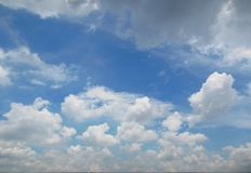 Fluffy cloud on clear blue sky. Bright blue sky with fluffy clouds royalty free stock photos
