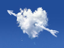 Fluffy cloud of the shape of heart + arrow Stock Images