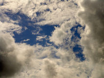 Fluffy clouds. In the sky Stock Photos