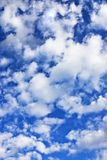 Fluffy clouds. A blue sky and white fluffy clouds Stock Image