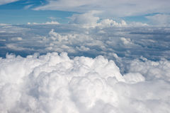 Fluffy clouds. Aerial view on white fluffy clouds Royalty Free Stock Images