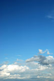 Fluffy clouds. In bright blue sky Stock Image
