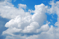 Fluffy clouds. On blue sky Stock Image