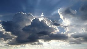 Beatiful fluffy clouds. Fluffy clouds, during the afternoon hours in summer royalty free stock images