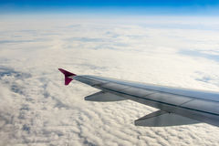 Fluffy clouds and airplane wing Stock Photo