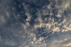 Fluffy clouds background over blue sky stock photo