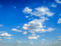 Fluffy Clouds background. Slightly clouded sky for background Royalty Free Stock Image