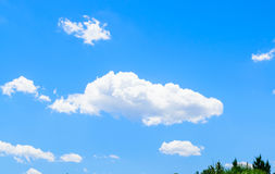 Fluffy clouds and blue skies Stock Images