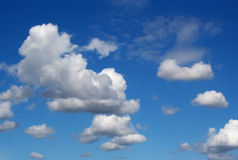 Fluffy Clouds in Blue Sky Stock Photo