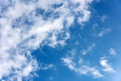 Fluffy clouds in the blue sky. Background stock photos