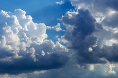 Fluffy clouds in the blue sky. Royalty Free Stock Photo