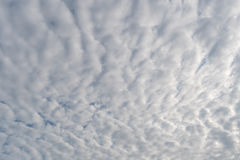 Fluffy clouds in blue sky background Stock Photo