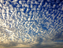 Fluffy Clouds in Blue Sky. The morning sky having fluffy white clouds makes a perfect natural beauty Royalty Free Stock Images