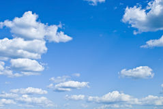 Fluffy clouds on a blue summer sky Royalty Free Stock Images