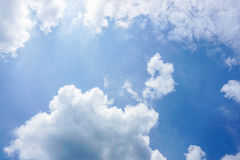 Fluffy clouds with deep blue sky. In the middle Royalty Free Stock Photo