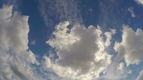 Fluffy clouds floating rapidly in evening summer sky, cloudscape timelapse stock video footage