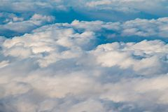 Fluffy Clouds. On on a sunny day seen from above Royalty Free Stock Images