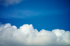 Fluffy Clouds. Frame of Fluffy White Clouds on Blue Sunny Sky background Outdoors Stock Images
