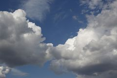 Fluffy clouds. The kiss of two fluffy clouds Stock Images
