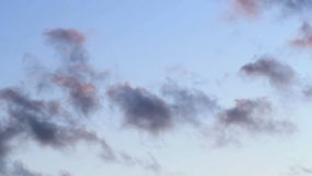 Fluffy clouds over blue sky on sunset. Clip of red, blue and fluffy clouds over blue sky on sunset stock video footage