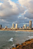 The fluffy clouds over hotels of quay in Tel Aviv Royalty Free Stock Photo