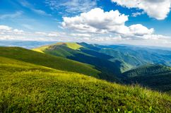 Fluffy clouds over the mountain ridge. Gorgeous summer landscape of Carpathian alps. fresh and green environment concept. beautiful travel background Royalty Free Stock Photos