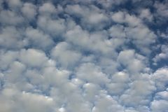 Fluffy clouds over the sky Royalty Free Stock Photography