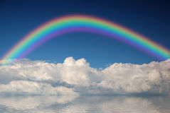 Fluffy clouds with rainbow Stock Photos