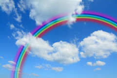 Fluffy clouds and rainbow Stock Images