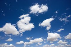 Fluffy clouds in sky. Stock Images