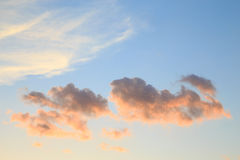 Fluffy clouds in the sky at sunset Royalty Free Stock Image