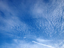 Fluffy Clouds spread in the sky Stock Photography