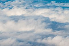 Fluffy Clouds. On on a sunny day seen from above Stock Photography