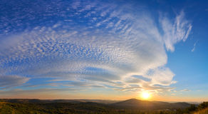 Fluffy clouds at sunset Stock Photography