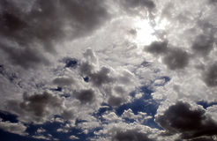 Fluffy Cloudy Deep Blue Sky Scape  Stock Photo
