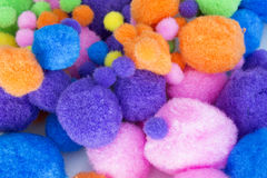 Fluffy colorful craft Pom Poms. This is a photograph of Fluffy colorful craft Pom Poms Royalty Free Stock Images