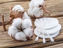 Fluffy cotton ball and cotton swabs and pads on wood. Stock Photography