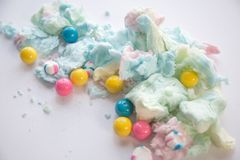 Fluffy cotton candy and gumballs. With selective focus on a white background stock photography