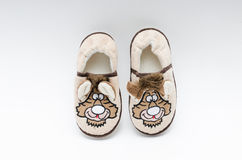 Fluffy cute kids slippers Stock Photos