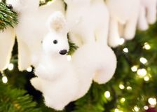 Fluffy cute little toy white, festive decoration of a Christmas tree, design greeting card congratulation background Royalty Free Stock Photography