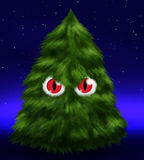 Fluffy evil fir tree with eyes. Funny fir tree - fluffy, red eyed and evil - under stars in the night Royalty Free Stock Photos