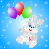 Fluffy hare with  balloons on a blue background Stock Photo