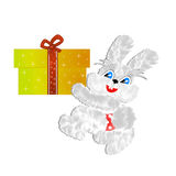 Fluffy hare with  a gift on a white background Stock Photography