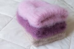 Fluffy hats of various styles and colors hand-knitted Stock Images